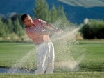golfer in sand trap at Sun Valley resort Kevin Syms Photography for Hotels and Resorts