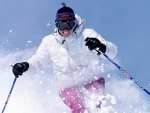 Gretchen Flint downhill skiing at Sun Valley resort Kevin Syms Photography for Hotels and Resorts
