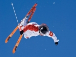 Skier caught in midair during a freestyle skiing Photography by Kevin Syms Sun Valley, Idahoetition.
