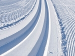 Cross country ski tracks wind towards Bald MountainPhotography by Kevin Syms Sun Valley, Idaho